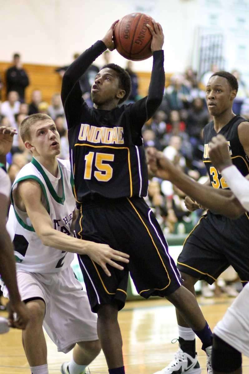 Uniondale C Shaquille Mosley #15, puts up the