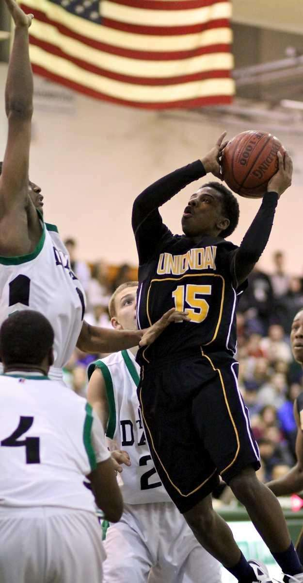 Uniondale C Shaquille Mosley #15, puts up a