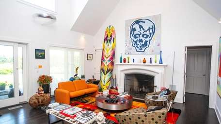 Nicole Miller's living room features a towering multicolored