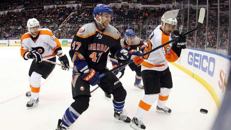 Andrew MacDonald of the Islanders defends against Philadelphia's