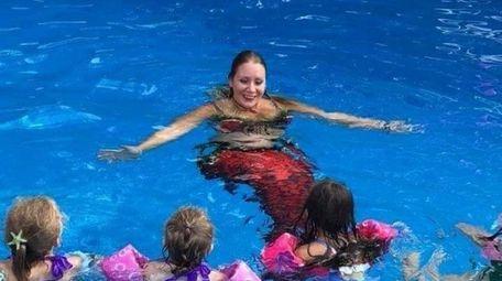 Mary Grecco, aka Mermaid Rose, entertains at Adi
