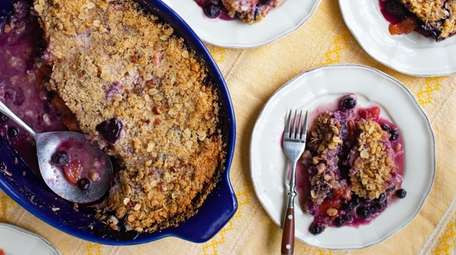 This blueberry-peach crisp features an oat-pecan topping.