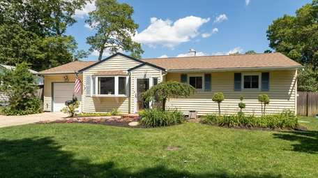 The West Islip ranch has three bedrooms and