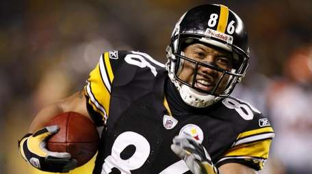 Hines Ward of the Steelers runs after a