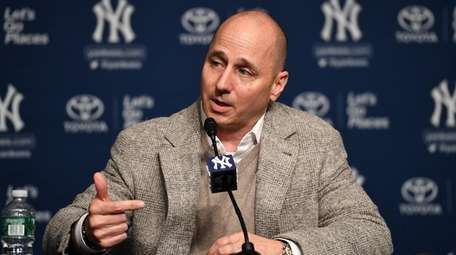 Brian Cashman answers questions during a news conference