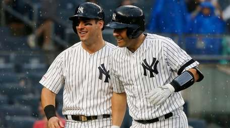 Austin Romine of the Yankees, right, celebrates his