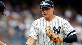 Masahiro Tanaka of the Yankees greets teammate Gio