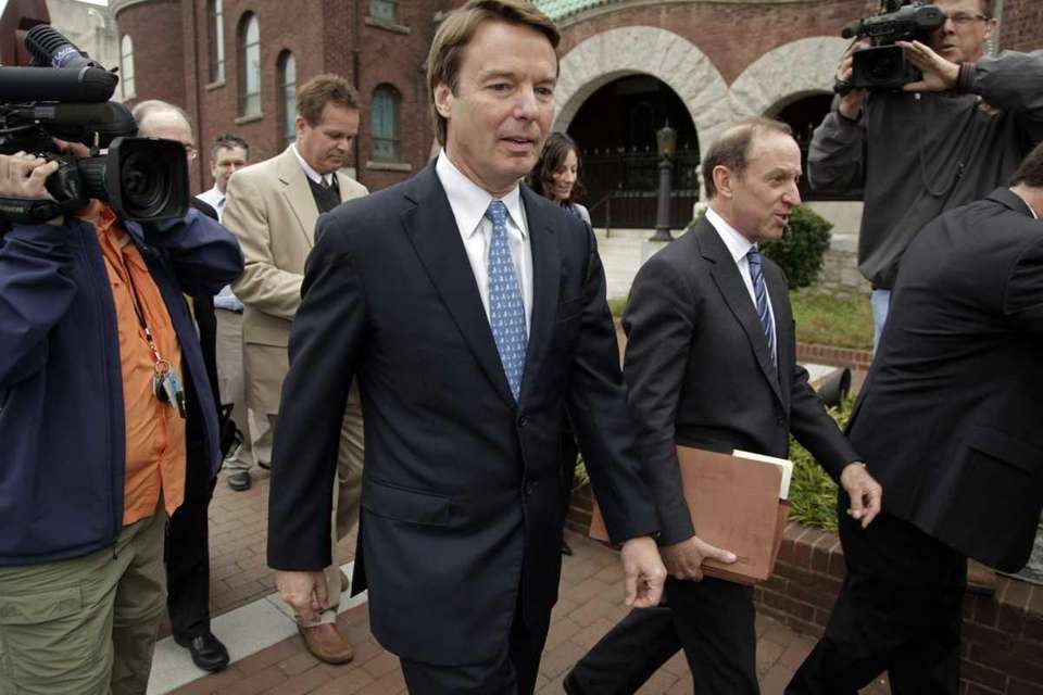 Former Senator and presidential candidate John Edwards, center,