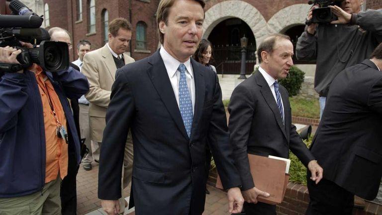 Former Senator and presidential candidate John Edwards, center,