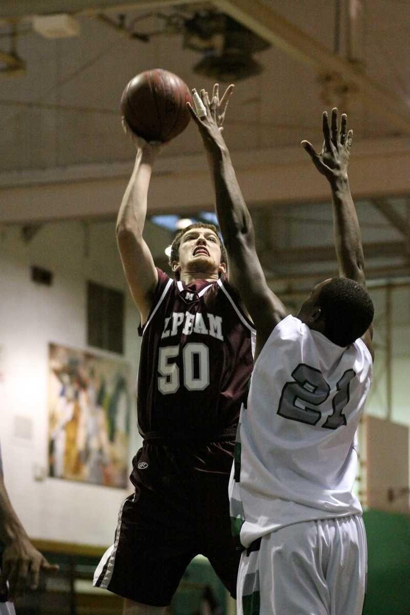 Mepham's Kris Waldron shoots the jumper. (Jan. 13,