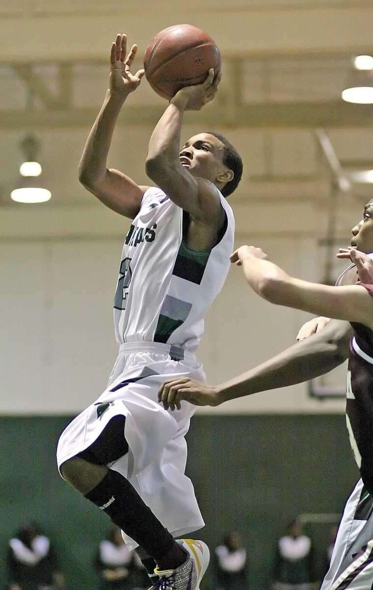 Elmont's Tristan Brown shoots a jumper. (Jan. 13,