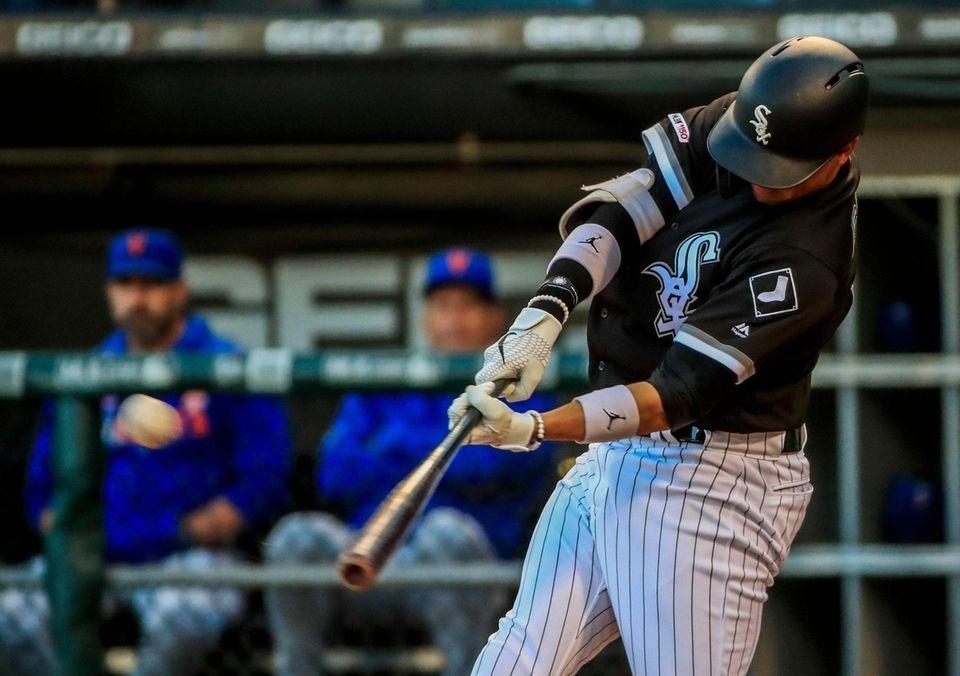 Chicago White Sox third baseman Ryan Goins hits