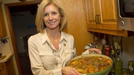 Beth Spiess displays her dish of venison meatball