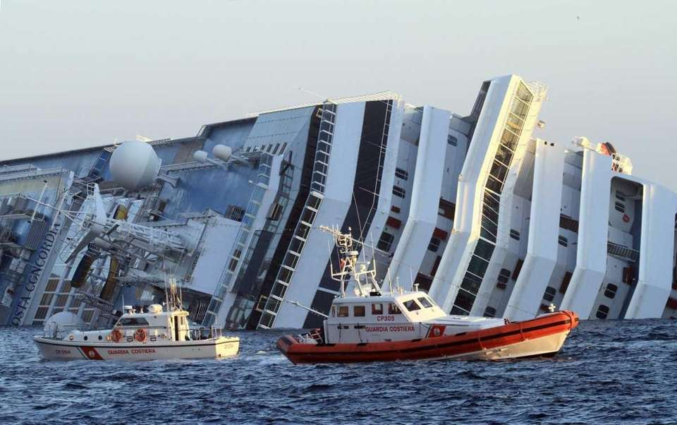 The luxury cruise ship Costa Concordia leans on
