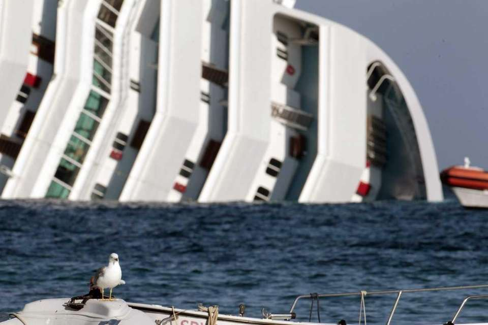 The luxury cruise ship Costa Concordia lies on