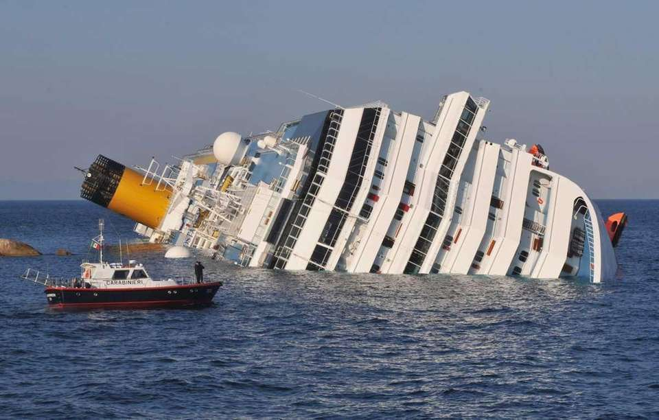 The cruise ship Costa Concordia lies stricken on