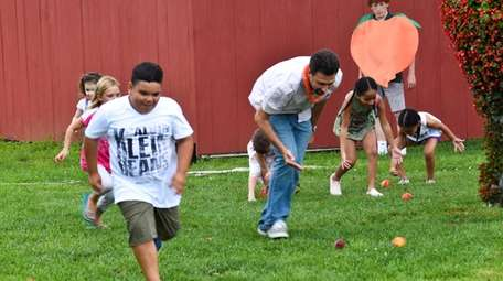 Visitors get a kick out of the peach-rolling