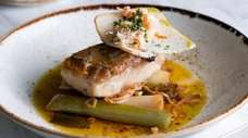 Roasted tilefish with vinegar-braised leeks, chive blossom and