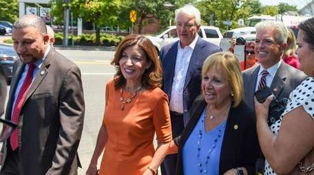 Lt. Gov. Kathy Hochul, surrounded by local politicians,