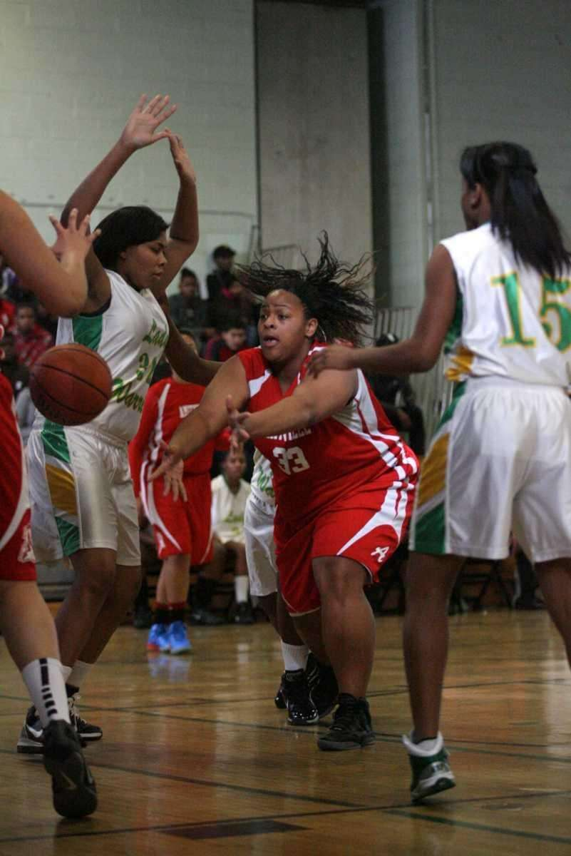 Amityville's Raven Price passes the ball during her