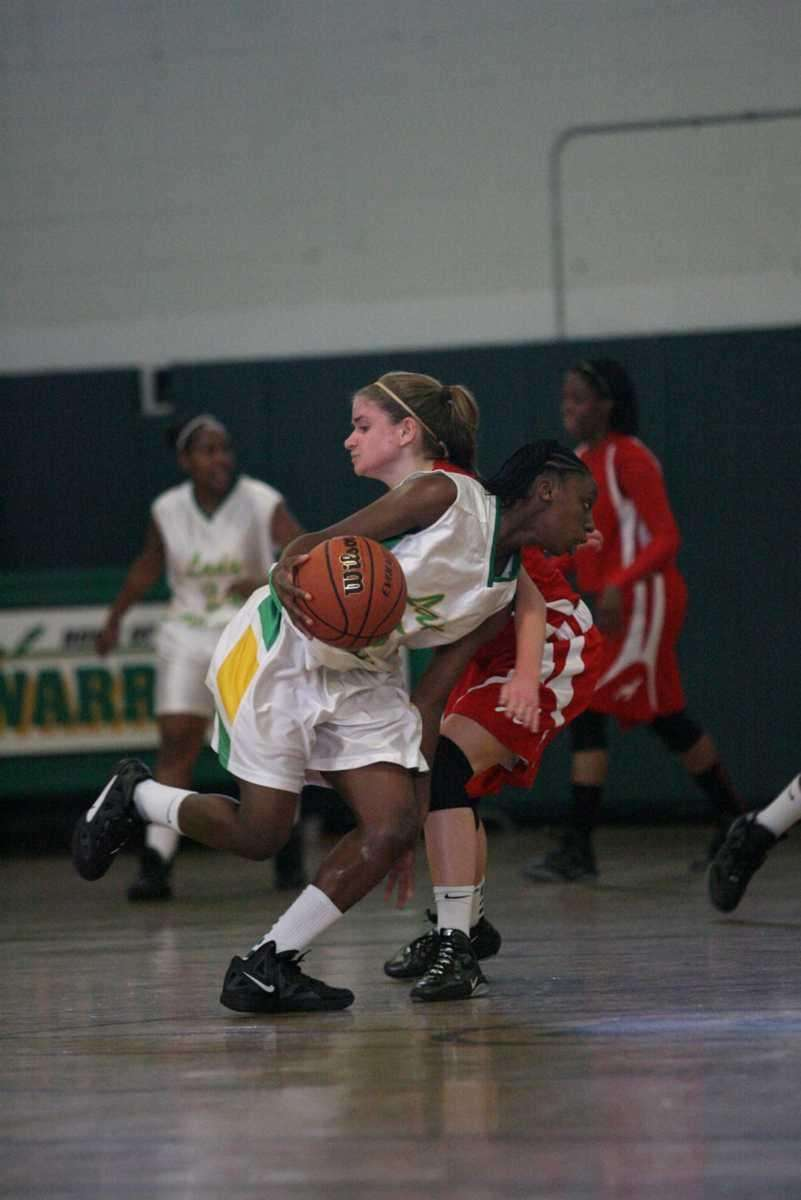 Wyandach's Jalicia Robinson drives past Amityville's Kelly Siry.
