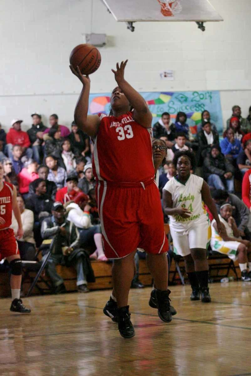 Amityville's Raven Price shoots for two points. (Jan.