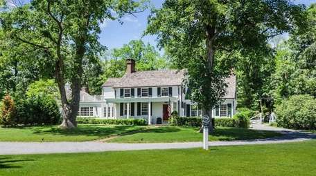 This Lloyd Harbor home has five fireplaces, formal