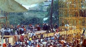 Concertgoers surround the stage as Joe Cocker performs