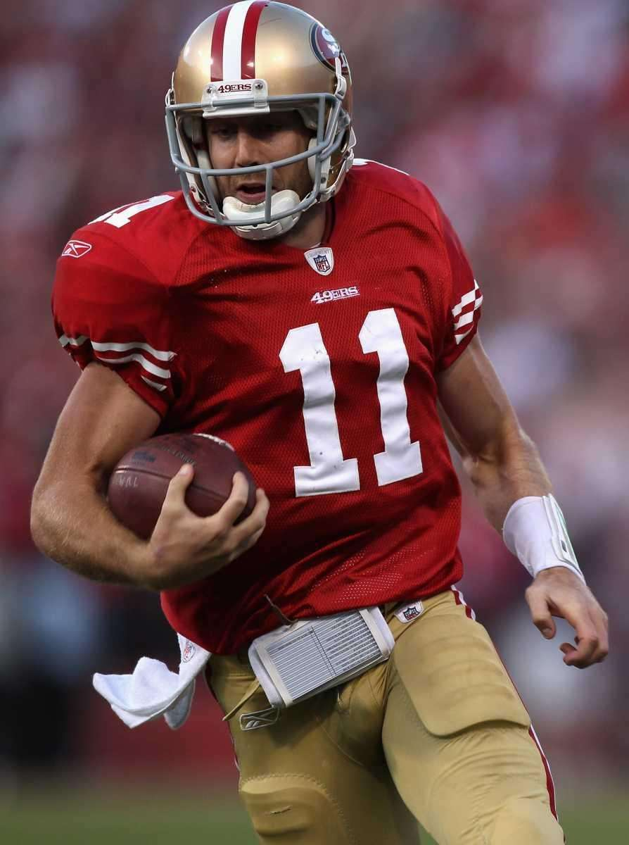 Alex Smith of the San Francisco 49ers runs