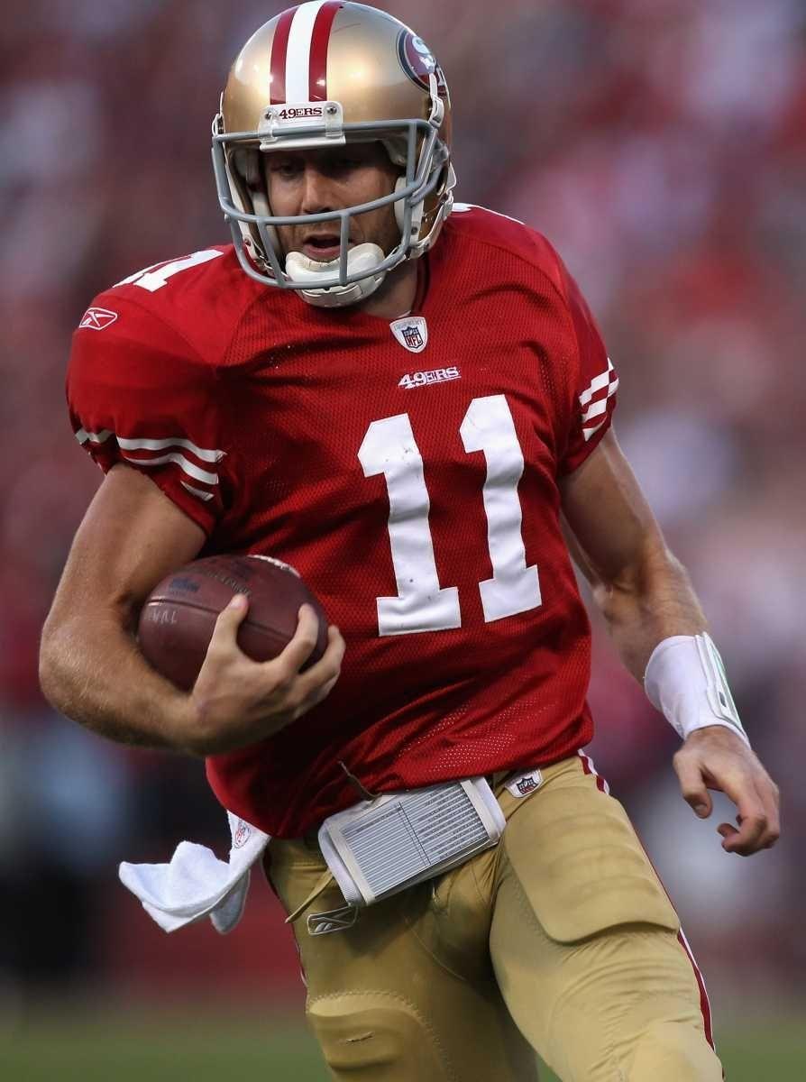 Alex Smith of the San Francisco 49ers runs