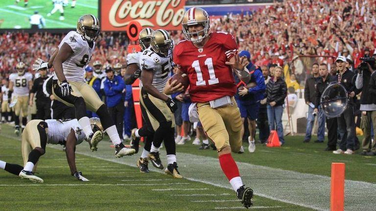 San Francisco 49ers quarterback Alex Smith crosses the