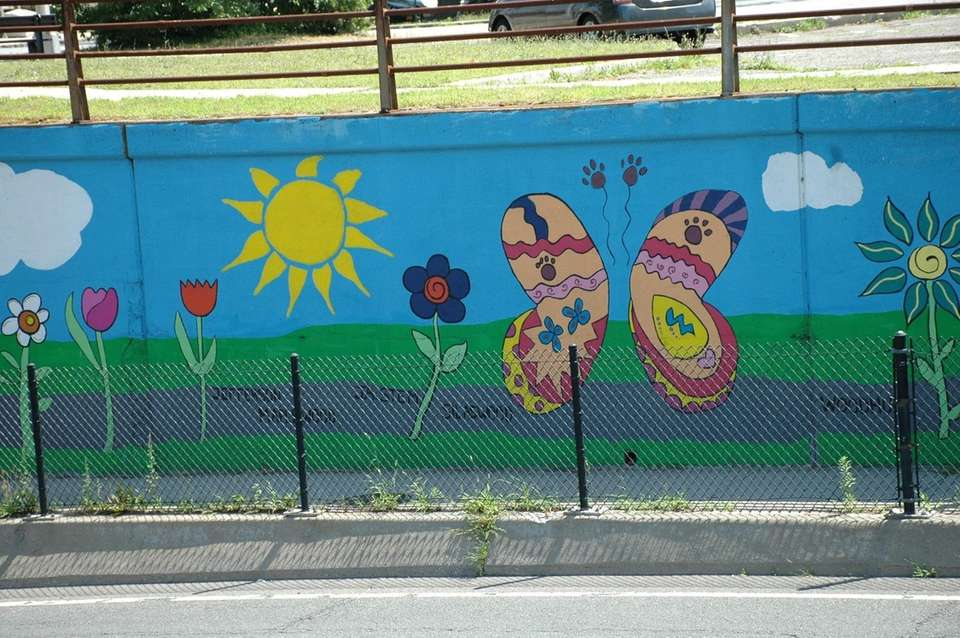 A mural continues along the side of the