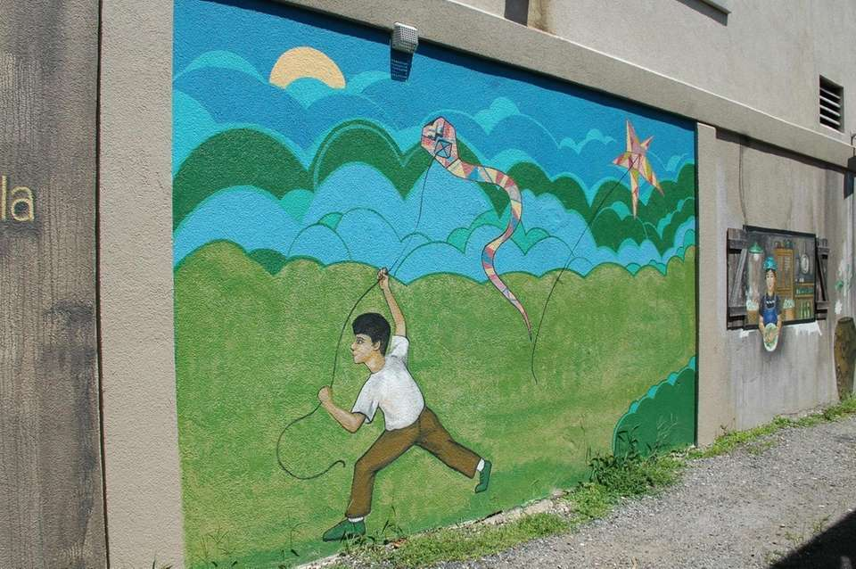 A mural of a boy flying a kite