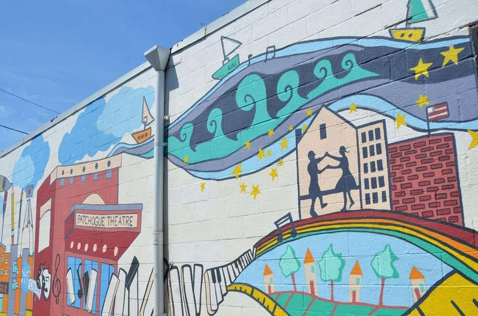 A mural in an alleyway on East Main
