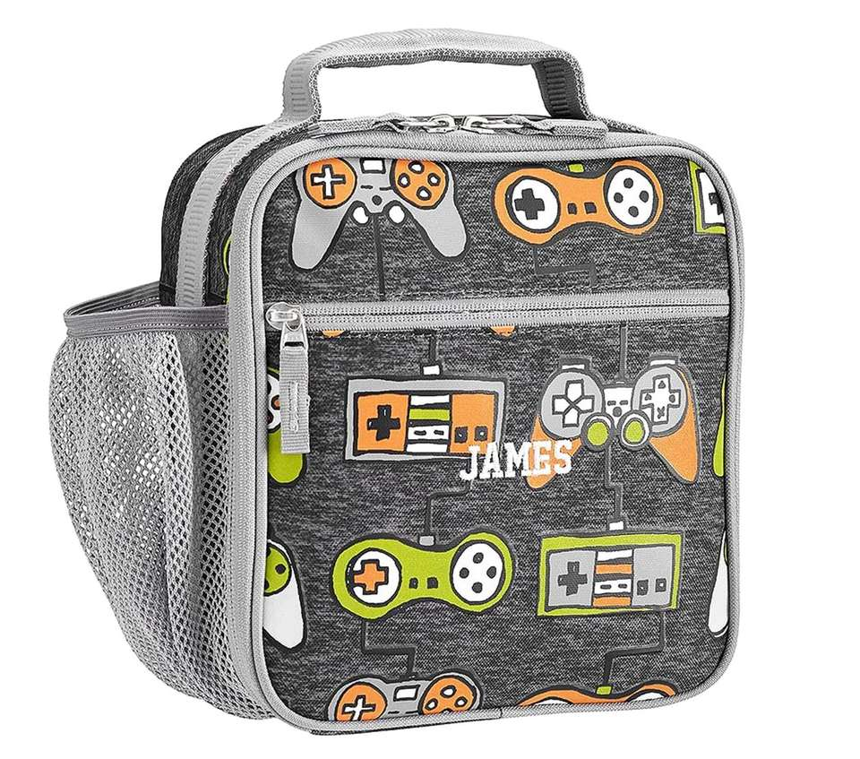 Decorated with drawings of various game controllers, this