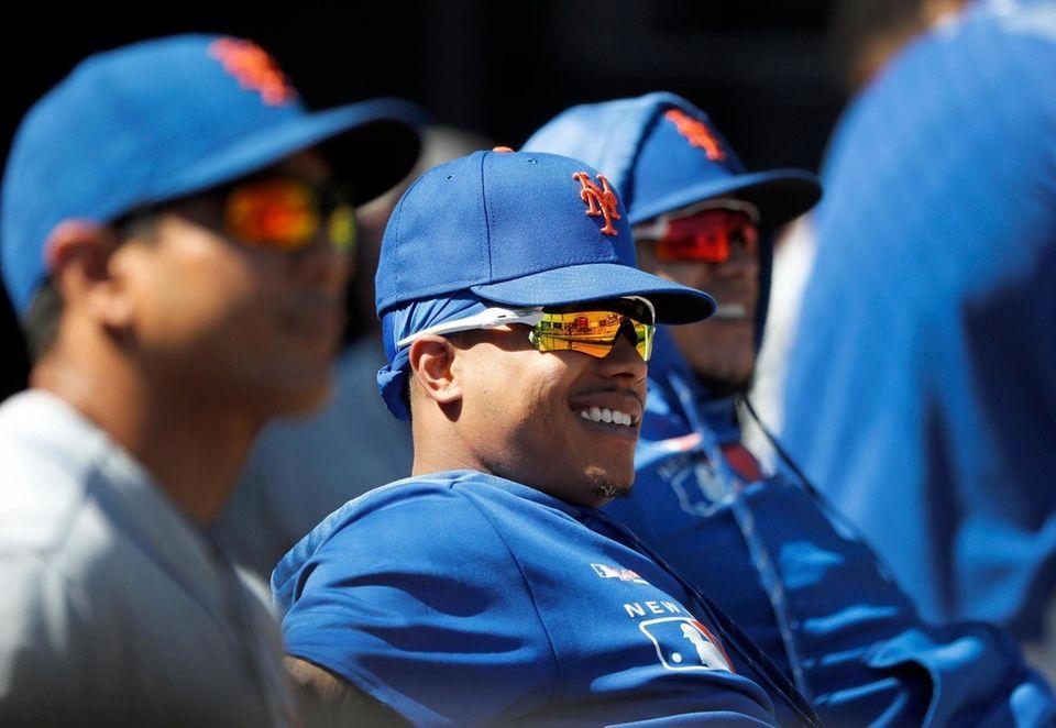 New York Mets' Marcus Stroman, center, smiles in