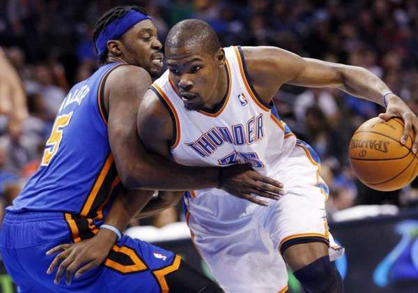 Oklahoma City Thunder forward Kevin Durant, right, drives