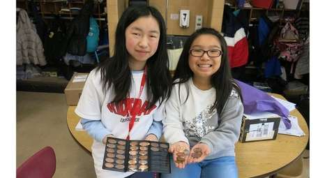 Kidsday reporters Chloe Ning, left, and Stephanie Yang