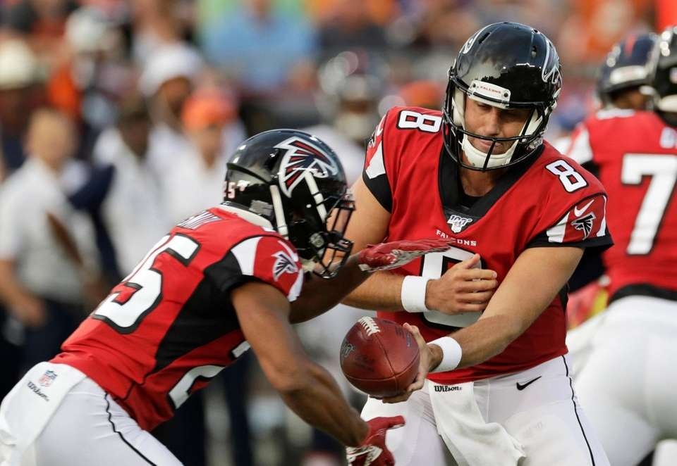 Atlanta Falcons quarterback Matt Schaub (8) hands the