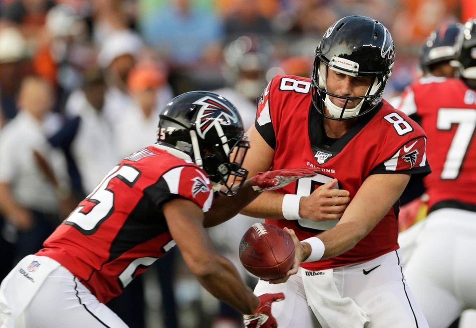 Atlanta Falcons quarterback Matt Schaub (8) hands the