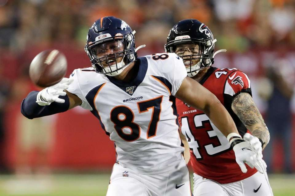 Denver Broncos tight end Noah Fant (87) reaches