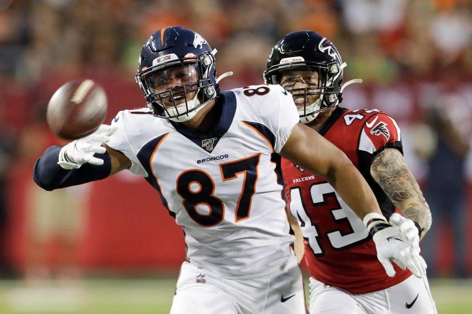 Denver Broncos tight end Noah Fant (87) reaches