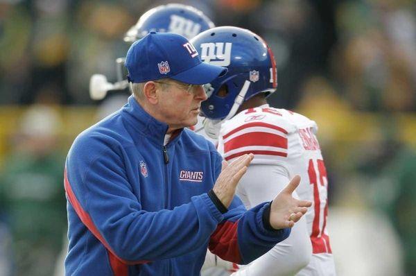 New York Giants head coach Tom Coughlin applauds