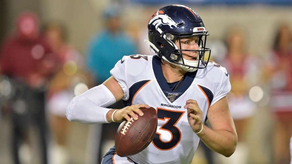 Denver Broncos quarterback Drew Lock scrambles during the