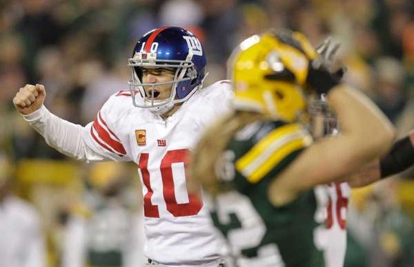 New York Giants quarterback Eli Manning reacts in