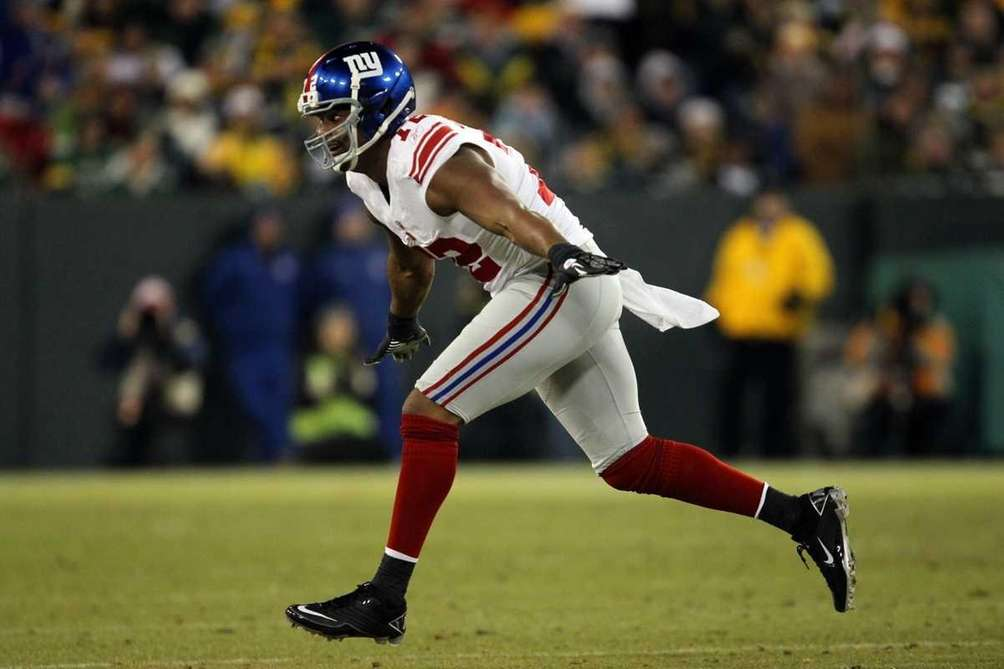 Osi Umenyiora celebrates after a tackle against the