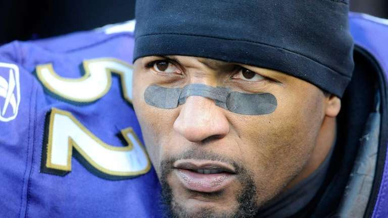Ray Lewis of the Baltimore Ravens looks on