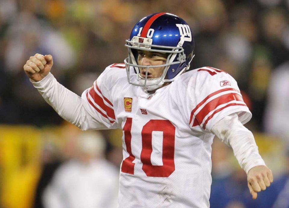 New York Giants quarterback Eli Manning reacts during