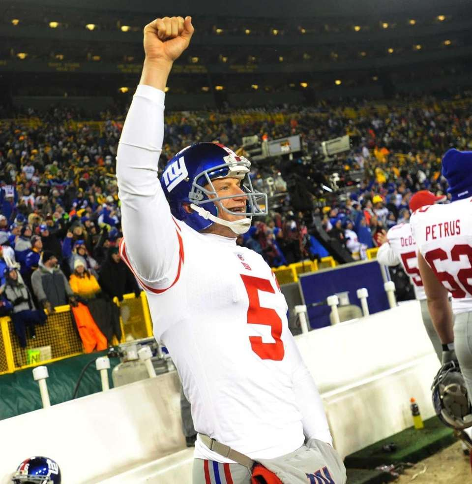 New York Giants Steve Weatherford celebrates his victory
