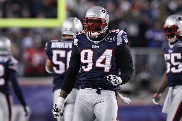Shaun Ellis of the New England Patriots celebrates